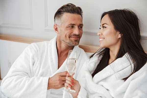 romantic-couple-30s-caucasian-man-and-asian-woman-PCF5QBX
